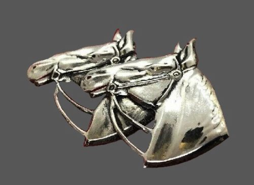Horse heads brooch of sterling silver