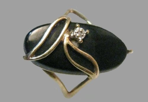Large oval shaped 10 K onyx and diamond ring, 1960's