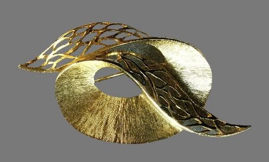 Looped swirl brooch. Gold tone textured metal, openwork