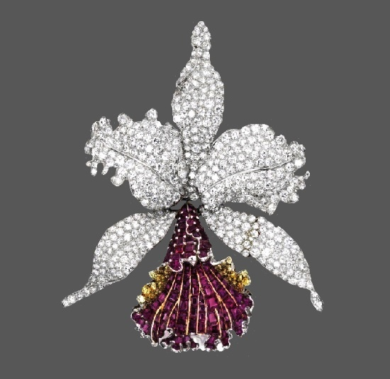 Orchid brooch. Platinum, 18 Karat Gold, Ruby, Diamond and Colored Diamond