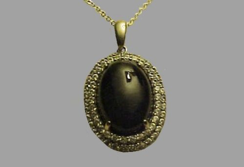 Oval shaped sterling silver pendant. Cabochon Charcoal Jade