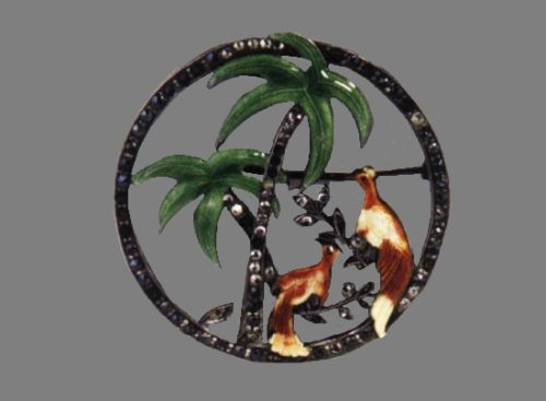 Palm and birds brooch. Sterling silver, green, yellow and brown enamel, rhinestones depicting two birds at the foot of two palm trees. 4,5 cm. Marked. 1938