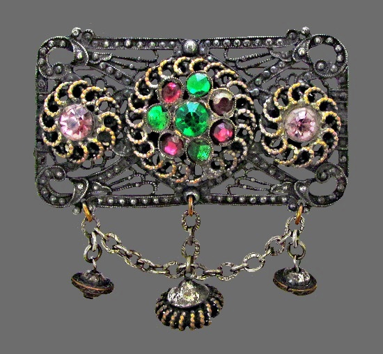 Rectangular brooch with charms. Jewelry alloy, crystals. 7 cm. 1950s