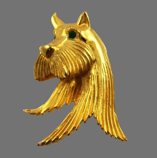 Scottie dog head brooch. Gold tone alloy, green eyes