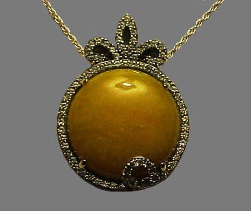 Sun pendant. Sterling silver, jadeite