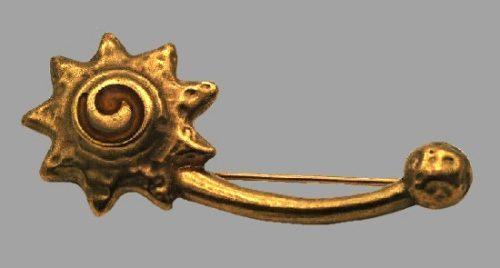 Sunburst brooch pin. Ancient gold tone