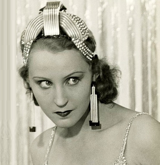 The star of the Metropolis Brigitte Helm in the earrings-skyscrapers and the diadem of Raymond Templier, 1928