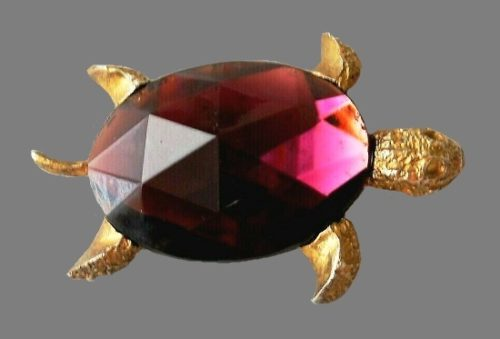 Turtle vintage brooch pin. Gold tone jewelry alloy, purple rhinestone