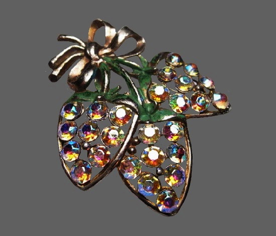 A cluster of strawberries with a bow brooch. Silver tone metal, rhinestones