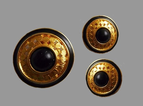A set of round earrings and scarf clip. Gold tone, black thermoset cabochon, black enamel edge