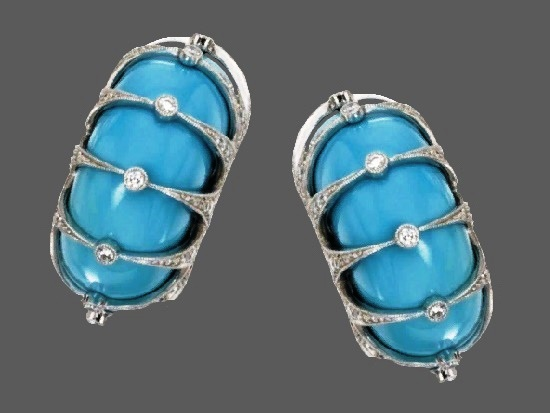 Blue earclips. 18 K white gold, turquoise and diamonds