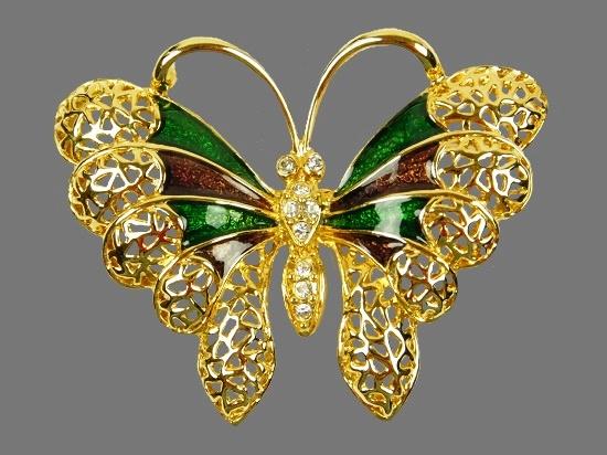 Butterfly brooch. Gold tone metal, enamel