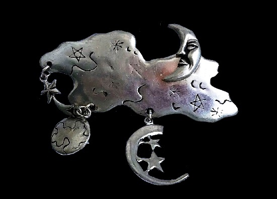 Cloud, moon, crescent and shooting star brooch. Dangling parts. Pewter, 6.5 cm. 1980s