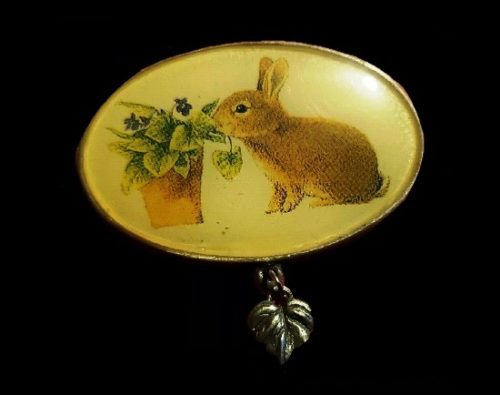 Easter rabbit oval shaped brooch with charms. 1999