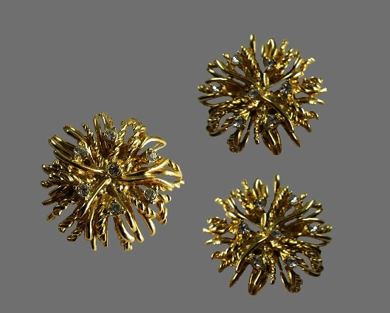 Floral design gold tone earrings with rhinestones