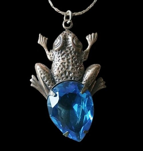 Frog pendant. Silver tone metal, blue glass
