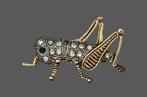 Grasshopper brooch of gold tone, gold plated, rhinestones