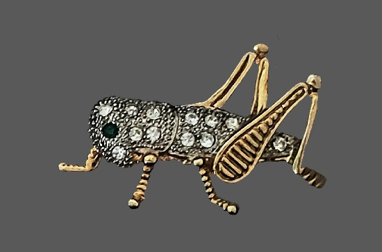 Grasshopper brooch of gold tone, gold plated, rhinestones