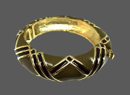 Green bracelet cuff. Gold tone metal, enamel