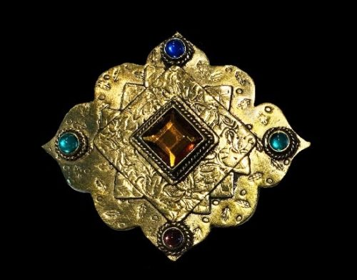 Handmade brass brooch, decorated with blue, green, purple and orange stones