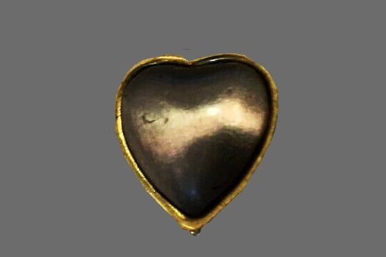 Heart pendant. Gold and silver tone