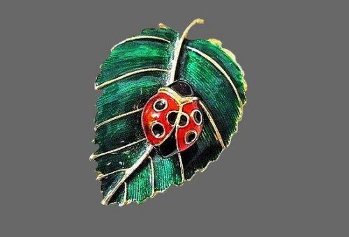 Leaf with ladybug brooch. Gold tone textured metal, green enamel