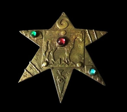 Lone horse on a star shaped brooch