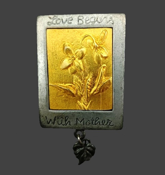 'Love begins with mother' silver and gold tone dangling brooch. 4 cm. 1990s