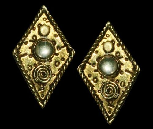 A pair of brass earrings. Gold tone textured metal. 1966