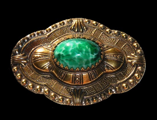 Oval shaped brooch pin. Copper gold tone metal, green cabochon
