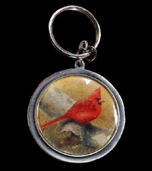Red Cardinal key ring pendant. Silver tone pewter, plastic, print. 1990s