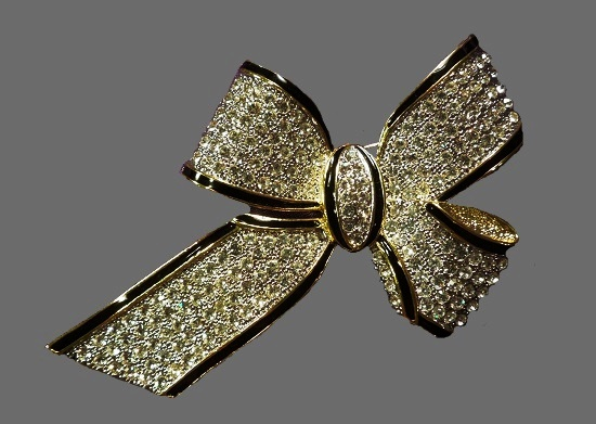 Rhinestone bow brooch. Gold tone metal, black enamel and rhinestones