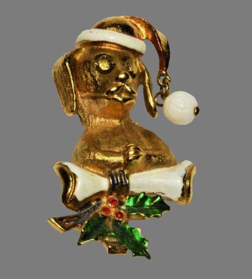 Santa Dog in a cap Christmas brooch. Gold tone metal, enamel