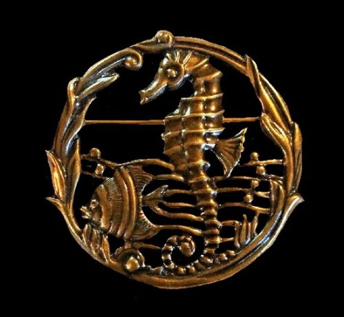 Seahorse and fish round shaped brooch of copper tone