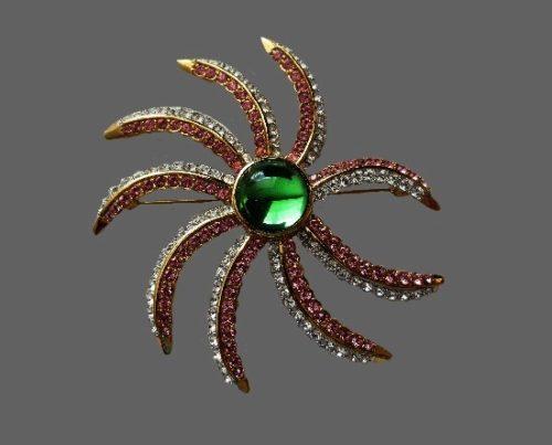 Seastar brooch. Gold tone metal, rhinestones, large green rhinestone. Signed Landau
