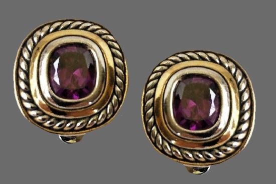 Silver and gold tone earrings with purple rhinestone