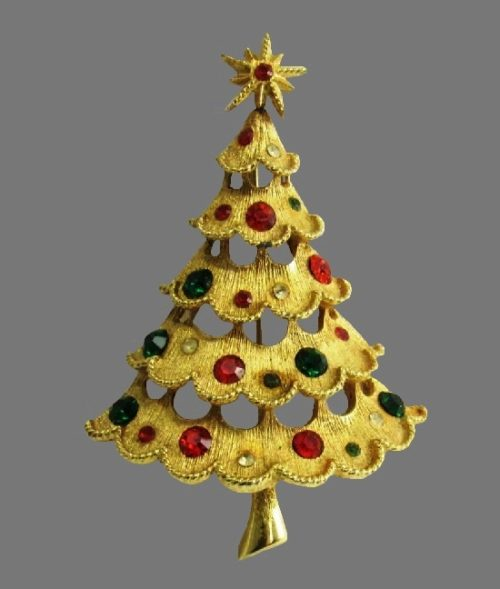 Star topped Christmas tree brooch of gold tone, rhinestones
