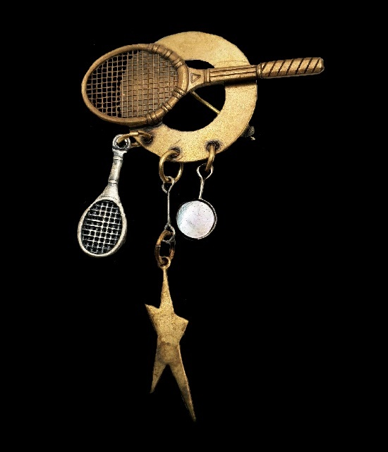 Tennis rackets star dangle pin of copper and silver tone. 1997