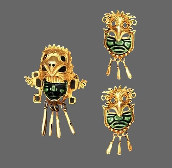 The set are in Mayan mask earrings and brooch. 14K gold plated, ceramic, dangle chimes