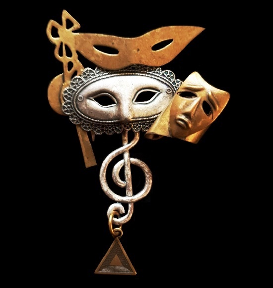 Theatrical masks dangle brooch. Gold and silver tone