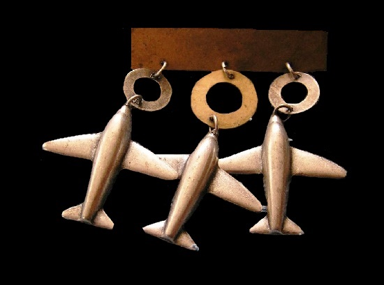Three airplanes dangle brooch of copper tone metal. 1992