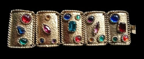 Big bangle bracelet. Gold tone metal , multi color rhinestones