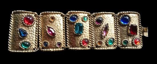 Big bangle bracelet. Gold tone metal , multi color rhinestones