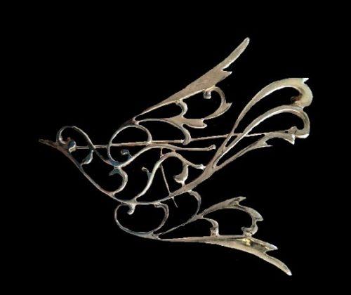 Bird in flight pin. Silver tone metal