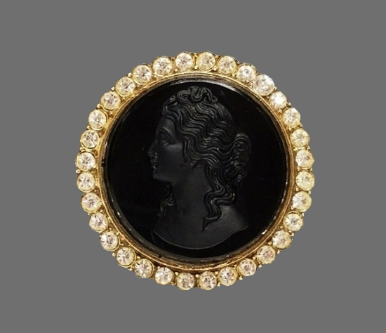 Black glass cameo brooch pendant. Gold tone metal, rhinestones