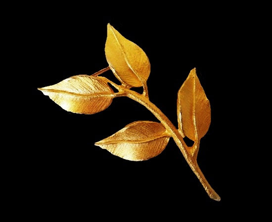 Branch with leaves brooch. Gold-tone textured metal. 8.5 cm. 1980s