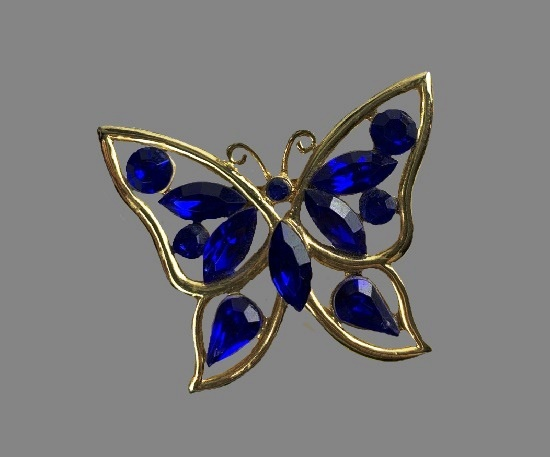 Butterfly brooch. Gold tone metal, blue art glass