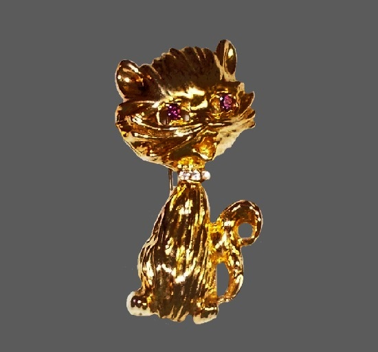 Cat pin. Gold tone, amethyst rhinestone eyes