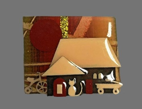Cream and black house pin with a cat and wagon