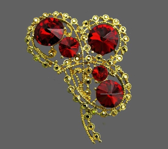 Dark red flower brooch. Gold tone metal, marcasite, art glass. 5.5 cm, 1970s